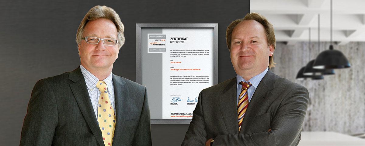 """Peter Reiner und Walter Lang, Geschäftsführer der U-S-C GmbH, freuen sich über das """"Zertifikat für Best of 2018 Qualitätsmanagement"""" Prüfsiegel für Gebrauchte Software"""